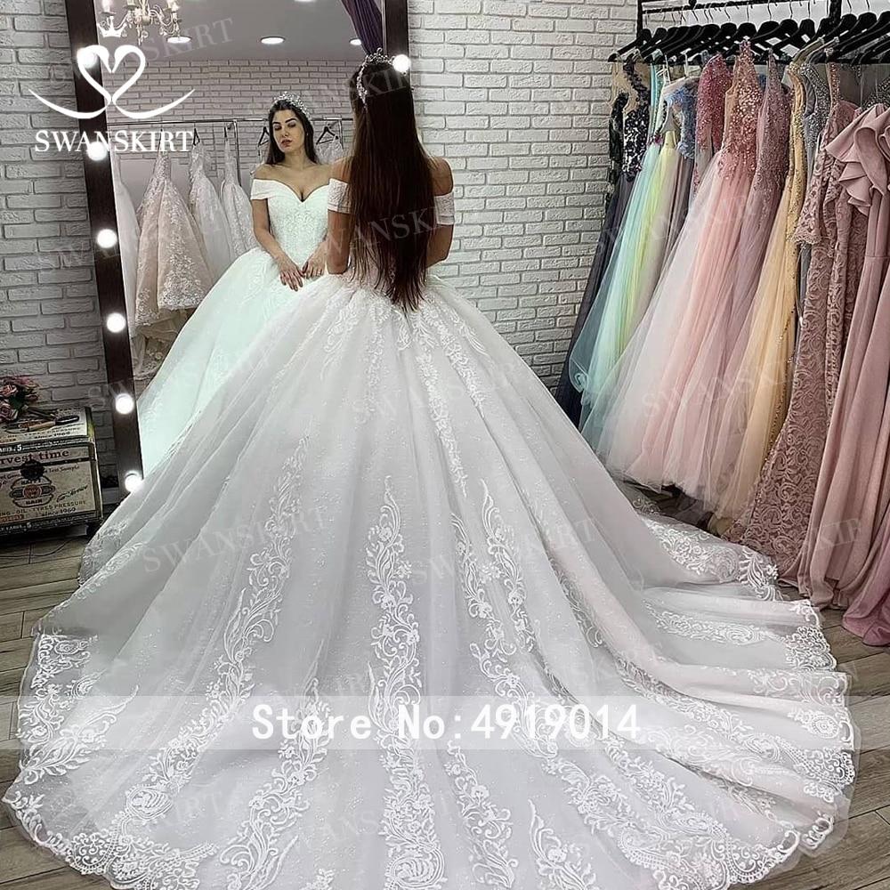 Luxury Beaded Princess Wedding Dress 2020 Swanskirt Appliques Lace up Ball Gown Illusion Bridal Customized Vestido de Noiva XZ03